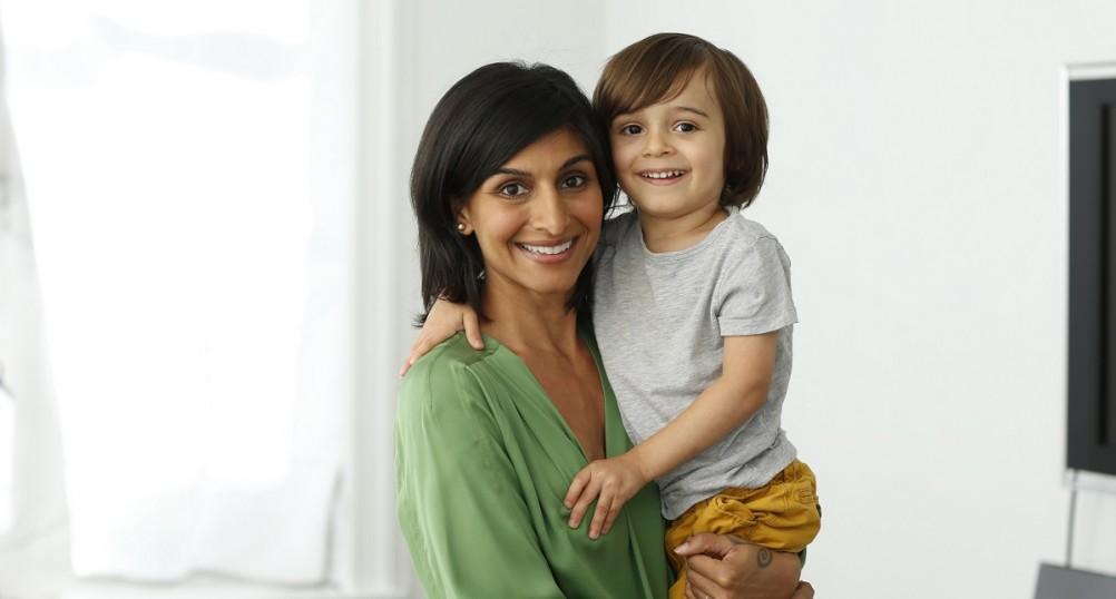 Shazi holding toddler Zane jpb